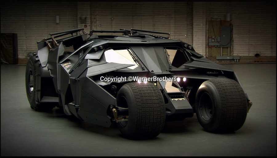 BNPS.co.uk (01202 558833)<br /> Pic: WarnerBrothers/BNPS<br /> <br /> ***Please Use Full Byline***<br /> <br /> The Batmobile that features in the most recent Batman film, The Dark Knight Rises (20/07/12).<br /> <br /> The world's first Batmobile has emerged for sale for a whopping £300,000 after being rescued from a field where it spent almost 50 years languishing.<br /> <br /> Batman's famous car was built more than 50 years ago from a 1956 Oldsmobile 88 that was converted to look just like the one from the comic books which made the Caped Crusader famous.<br /> <br /> It is a far cry from the Batmobile that appeared in Christopher Nolan's modern remakes of Batman.<br /> <br /> But as the first Batmobile ever built, experts at Dallas-based Heritage Auctions say it could sell for as much as $500,000 - more than £300,000.