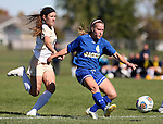 BROOKINGS, SD - OCTOBER 9:  Shelby Raper #4 from South Dakota State University gets a shot on goal past ara Seals #24 from Oral Roberts during their game Sunday afternoon at Fischback Park in Brookings. (Photo by Dave Eggen/Inertia)
