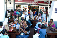 CAPE TOWN, SOUTH AFRICA - MARCH 21: Fastfood restaurants used by colored and black at Waterfront, a shopping and harbor area on March 21, 2012 in Cape Town, South Africa. (Photo by Per-Anders Pettersson)
