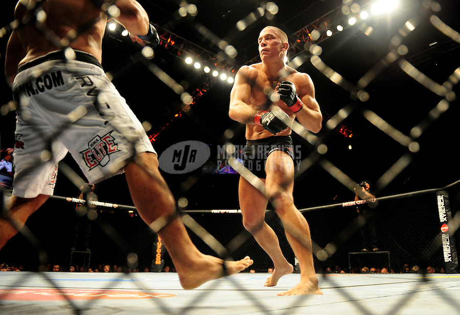 Jan. 31, 2009; Las Vegas, NV, USA; UFC fighter Georges St-Pierre (black trunks) against B.J. Penn (white trunks) during the welterweight championship in UFC 94 at the MGM Grand Hotel and Casino. St-Pierre defeated Penn with a fourth round TKO. Mandatory Credit: Mark J. Rebilas-