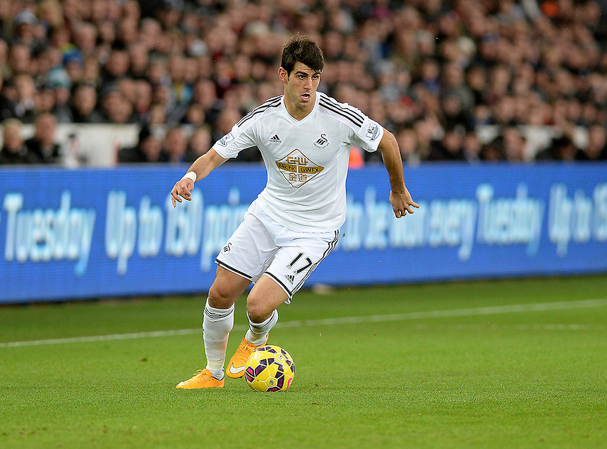 Swansea City's Miguel Nelson Oliveira in action during todays match  <br /> <br /> Photographer /Ashley CrowdenCameraSport<br /> <br /> Football - Barclays Premiership - Swansea City v Chelsea - Saturday 17th January 2015 - Liberty Stadium - Swansea<br /> <br /> &copy; CameraSport - 43 Linden Ave. Countesthorpe. Leicester. England. LE8 5PG - Tel: +44 (0) 116 277 4147 - admin@camerasport.com - www.camerasport.com