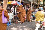 Street scene with Buddhist monks. Bangkok, Thailand