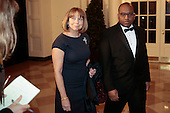 Jill Abramson, executive editor of the New York Times Co., left, and William Woodson arrive at a state dinner hosted by U.S. President Barack Obama and U.S. First Lady Michelle Obama in honor of French President Francois Hollande at the White House in Washington, D.C., U.S., on Tuesday, Feb. 11, 2014.<br />