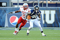 9 October 2010:  FIU wide receiver Jason Frierson (80) is pursued by Western Kentucky cornerback Derrius Brooks (2) while returning a punt in the fourth quarter as the FIU Golden Panthers defeated the Western Kentucky Hilltoppers, 28-21, at FIU Stadium in Miami, Florida.