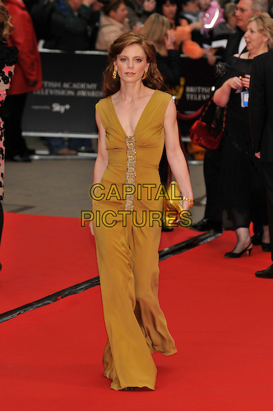 EMILIA FOX .Red Carpet Arrivals for the British Academy Television Awards 2008, held at the London Palladium, London, England, April 20th 2008. .BAFTA BAFTA's full length gold dress clutch bag .CAP/PL.©Phil Loftus/Capital Pictures