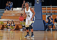Florida International University guard Kamika Idom (14) plays against Western Kentucky University.  FIU won the game 60-56 on January 28, 2012 at Miami, Florida. .