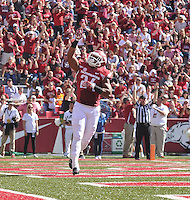 NWA Media/Michael Woods --10/25/2014-- w @NWAMICHAELW...University of Arkansas fullback Kody Walker celebrates after scoring a touchdown against UAB in the 2nd quarter of Saturday's game at Razorback Stadium in Fayetteville.