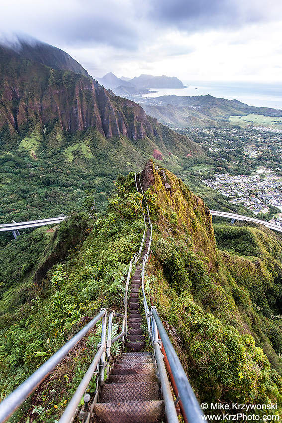 "An aerial view of the  Ko'olau mountain range & H-3 freeway  at dawn from Haiku Stairs (""Stairway to Heaven"") hiking trail in Kaneohe, Oahu"
