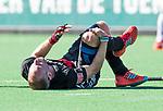 BLOEMENDAAL   - Hockey -  2e wedstrijd halve finale Play Offs heren. Bloemendaal-Amsterdam (2-2) . A'dam wint shoot outs. blessure bij Teun Rohof (A'dam).  COPYRIGHT KOEN SUYK