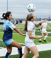 NWA Democrat-Gazette/BEN GOFF @NWABENGOFF<br /> Abby Stolt (right) of Bentonville wins a header vs Gisselle Estrada of Springdale Har-Ber Tuesday, March 12, 2019, during the match at Wildcat Stadium in Springdale.