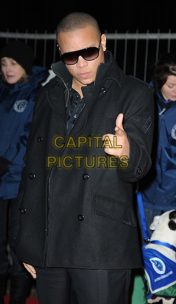 DJ IRONIK (Michael Laurence / James Charters).Collars and Coats Gala marking Battersea Dogs & Cats Home's 150th Anniversary at Battersea Power Station, Battersea, London, England, UK, November 25th 2010..half length black coat sunglasses hand finger pointing .CAP/WIZ.© Wizard/Capital Pictures.