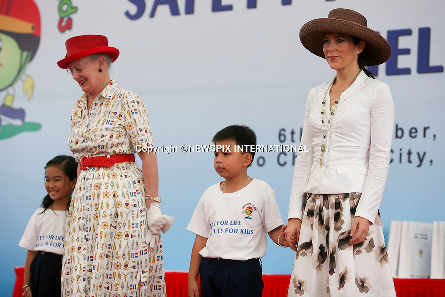 "Queen Margrethe and Crown Princess Mary.Visit Maersk to promote a helmet wearing campaign with street children. Ho Chi Minh City Vietnam_06/11/2009..Mandatory Photo Credit: ©Dias/Newspix International..**ALL FEES PAYABLE TO: ""NEWSPIX INTERNATIONAL""**..PHOTO CREDIT MANDATORY!!: NEWSPIX INTERNATIONAL(Failure to credit will incur a surcharge of 100% of reproduction fees)..IMMEDIATE CONFIRMATION OF USAGE REQUIRED:.Newspix International, 31 Chinnery Hill, Bishop's Stortford, ENGLAND CM23 3PS.Tel:+441279 324672  ; Fax: +441279656877.Mobile:  0777568 1153.e-mail: info@newspixinternational.co.uk"