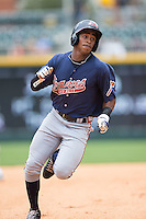 Mallex Smith (8) of the Gwinnett Braves hustles towards third base against the Charlotte Knights at BB&T BallPark on July 3, 2015 in Charlotte, North Carolina.  The Braves defeated the Knights 11-4 in game one of a day-night double header.  (Brian Westerholt/Four Seam Images)