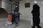 A Druze teen in charge of the sound system at a rally supporting Syrian president Assad, held by Druze in Majdal Shams, Golan Heights.