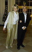 Martha Stuart and her date John Cuti arrive at the White House on December 20, 2000 in Washington DC. Stuart was attending a dinner hosted by United States President Bill Clinton for the National Medal of Arts awardees..Credit: Mark Wilson / Pool via CNP