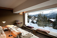 The chalet has stunning views of the mountains surrounding Cortina D'Ampezzo from a large picture window in the open plan living area