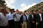"""Palestinian Prime Minister Salam Fayyad attends a ceremony inaugurating a new street in the West Bank  village of Qarawa Bani Hassan near Nablus Wednesday, Sept. 1 , 2010. Fayyad's office issued a statement condemning the Palestinian shooting attack on Tuesday that killed four Israelis, saying it was aimed at undermining his government's effort to build international support for """"the Palestinian position and ending the (Israeli) occupation."""" . Photo by Mustafa Abu Dayeh / Pool"""