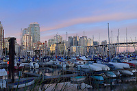Vancouver area showing apartment, office blocks marina and Granville bridge at dusk. British Columbia, Canada