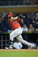 Juan Graterol (3) of the Louisville Bats follows through on his swing against the Durham Bulls at Durham Bulls Athletic Park on May 28, 2019 in Durham, North Carolina. The Bulls defeated the Bats 18-3. (Brian Westerholt/Four Seam Images)