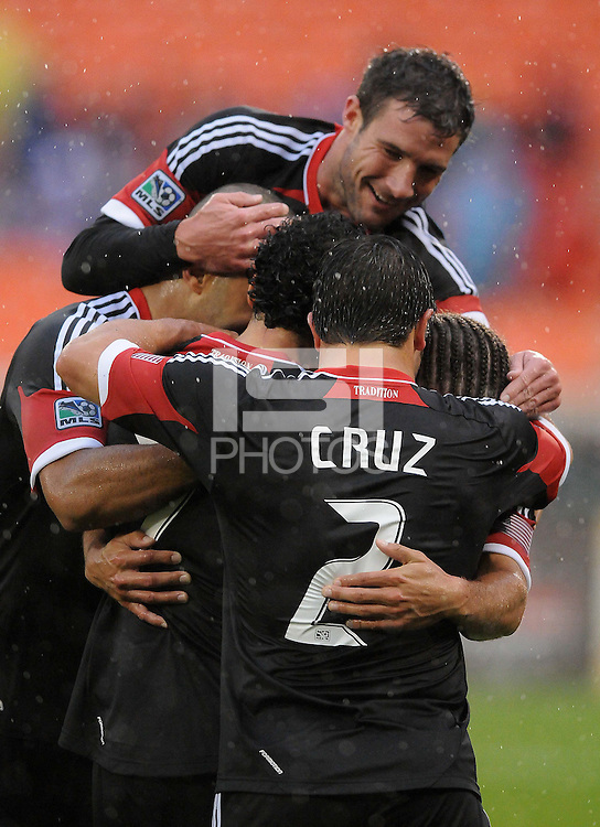 D.C. United midfielder Nick DeLeon (18) celebrates with team mates his score in the 36th minute of the game. D.C. United defeated The New York Red Bulls 4-1 at RFK Stadium, Sunday April 22, 2012.