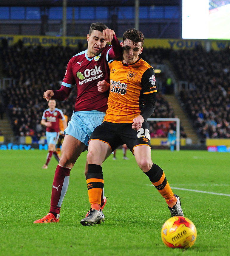 Burnley's Matthew Lowton vies for possession with Hull City's Andrew Robertson<br /> <br /> Photographer Chris Vaughan/CameraSport<br /> <br /> Football - The Football League Sky Bet Championship - Hull City v Burnley - Saturday 26th December 2015 - Kingston Communications Stadium - Hull<br /> <br /> &copy; CameraSport - 43 Linden Ave. Countesthorpe. Leicester. England. LE8 5PG - Tel: +44 (0) 116 277 4147 - admin@camerasport.com - www.camerasport.com