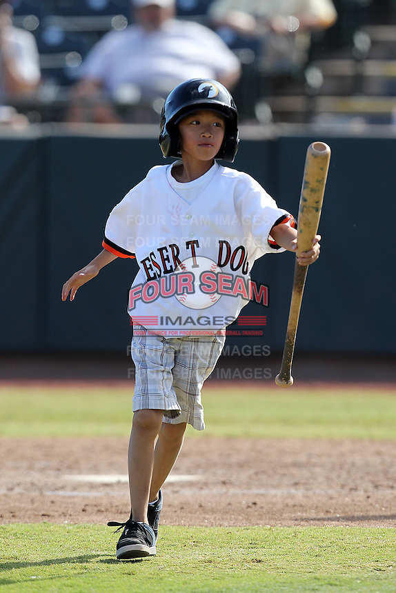 Bat boy during an Arizona Fall League game between the Phoenix Desert Dogs and Salt River Rafters at Phoenix Municipal Stadium on November 1, 2011 in Phoenix, Arizona.  Salt River defeated Phoenix 10-7.  (Mike Janes/Four Seam Images)