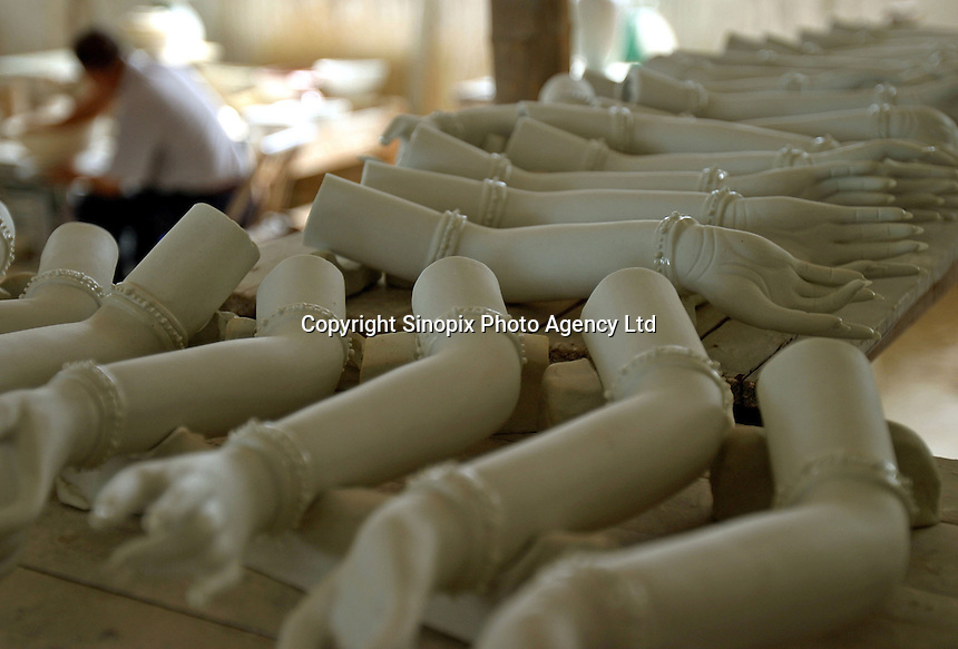 Exquistitly made porcelain arms and hands lay on a rack at a porcelain workshop in Jingdezhen, Jiangxi Province, China. The township of Jingdezhen is well known in China as the country's porcelain capital ever since it was selected exactly one thousand years ago as the royal porcelain provider for the imperial court..24-JUN-04