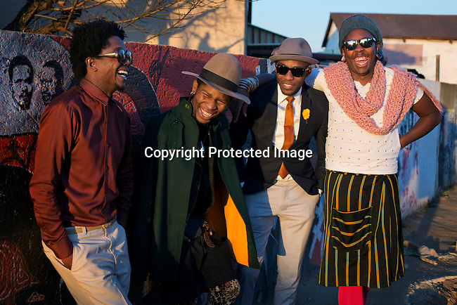 SOWETO, SOUTH AFRICA JULY 4: Teekay Makwale, Floyd Avenue, Lethabo Tsatsinyane and Sibu Sithole young designers part of the group Smarteez  poses for pictures next to a struggle mural on July 4, 2014 in Soweto, South Africa. Soweto today is a mix of old housing and newly constructed townhouses. A new hungry black middle-class is growing steadily. Many residents work in Johannesburg but the last years many shopping malls have been built, and people are starting to spend their money in Soweto. (Photo by: Per-Anders Pettersson)
