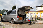 Europe Virus Outbreak - Cemetery Works in Pergine Valsugana, Italy on April 21, 2020. A sweeping lockdown is in place in Italy to try to slow down the spread of coronavirus pandemic. Employee wearing gloves and masks disinfect a coffin of a person who died of a heart attack.