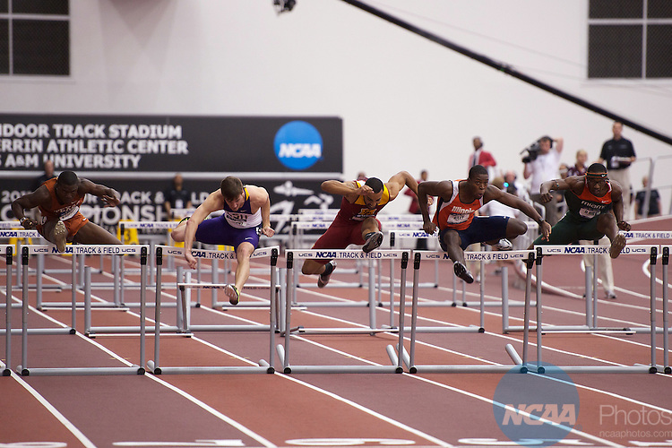 12 MAR 2011:   Andrew Riley, center, of Illinois clears the final hurdle of the 60 Meter Hurdles during the Division I Men's and Women's Indoor Track and Field Championship held at the Gilliam Indoor Track Stadium on the Texas A&M University campus in College Station, TX.   Riley ran a 7.58 for the national title.  Dave Einsel/ NCAA Photos