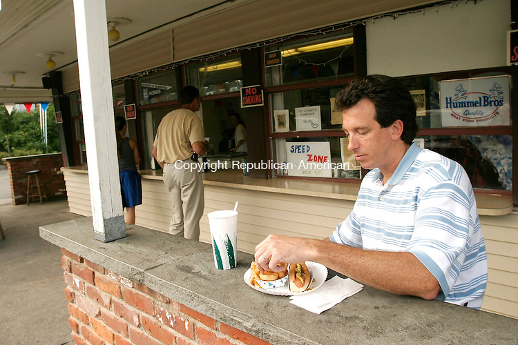 OXFORD, CT - 19 JULY 2005 -071905JS04--Jack Traver of Middlebury enjoys his hot dog and onion rings during a stop at Johnny's in Middlebury.  --Jim Shannon Photo--Johnny's; Middlebury; Jack Traver are CQ