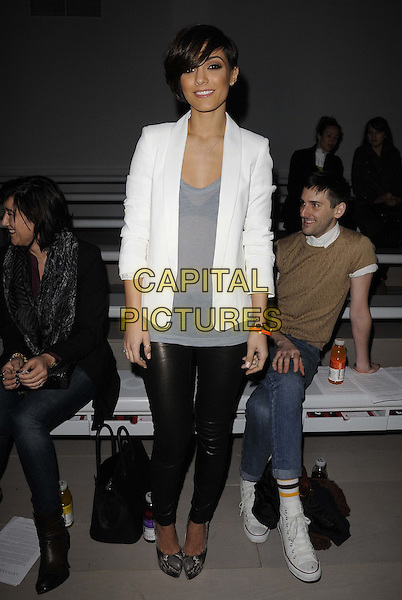 Frankie Sandford of The Saturdays.The Aminaka Wilmont a/w 2012 catwalk show, London Fashion Week, Day 5, BFC Show Space, Somerset House, The Strand, London, England..February 21st, 2012.LFW full length white blazer black leather trousers grey gray top shoes .CAP/CAN.©Can Nguyen/Capital Pictures.