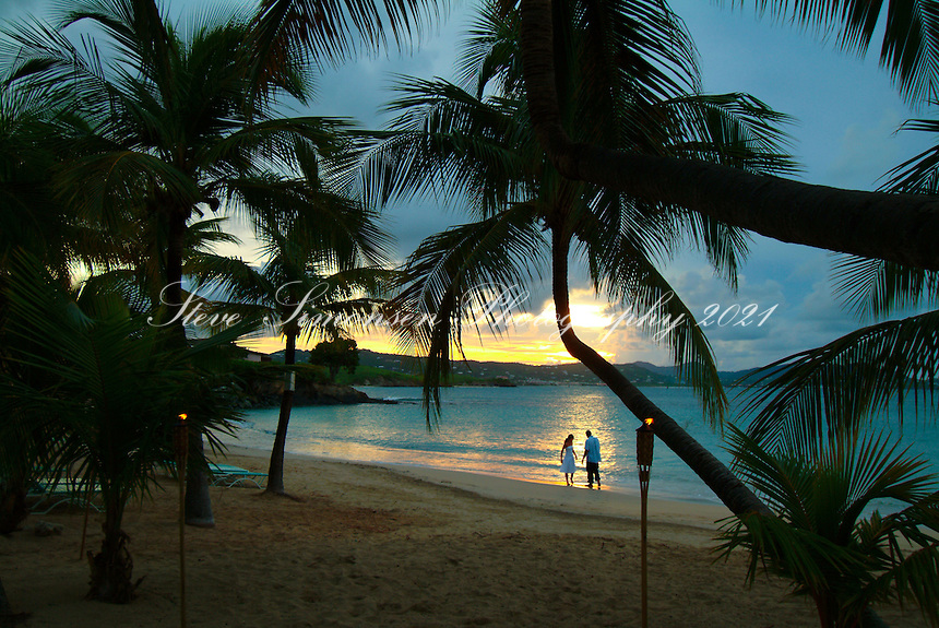 Couple on the beach at <br /> The Buccaneer, St Croix<br /> U.S Virgin Islands