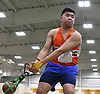 Jason Wang of Great Neck South generates momentum for a weight throw during the event's Nassau County championship and state qualifier at St. Anthony's High School on Monday, Feb. 6, 2017.