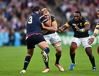 Schalk Burger of South Africa is tackled by Chris Baumann of the USA. Rugby World Cup Pool B match between South Africa and the USA on October 7, 2015 at The Stadium, Queen Elizabeth Olympic Park in London, England. Photo by: Patrick Khachfe / Onside Images