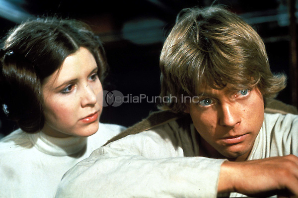 CARRIE FISHER &amp; MARK HAMILL<br /> as Princess Leia &amp; Luke Skywalker in Star Wars  <br /> Filmstill - Editorial Use Only<br /> Ref: 4546<br /> CAP/AWFF<br /> Supplied by Capital Pictures /MediaPunch ***NORTH AND SOUTH AMERICAS ONLY***