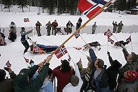 2003 Iditarod champion Robert Sorlie of Norway waves his Country's flag to well-wishers during the Willow Restart.  2005 Iditarod Sled Dog Race