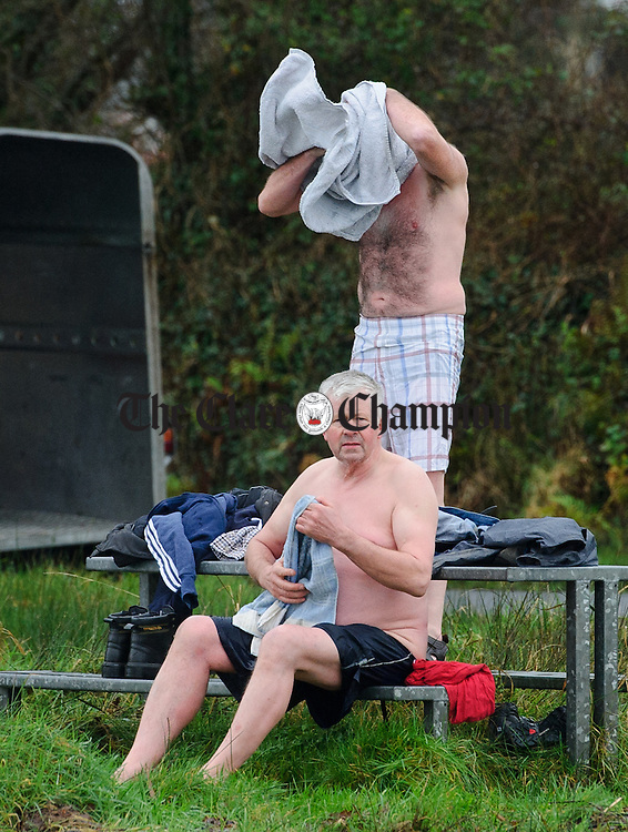 John Dolan and Joe Normoyle dry off after taking part in the annual Christmas day swim at Gortglas  Lake, Kildysart in aid of the West Clare Mini Marathon Cancer fund. Photograph by John Kelly.