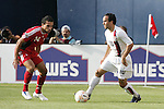21 June 2007:  United States midfielder Landon Donovan (10) looks to elude Canada's Dwayne DeRosario (14). The United States Men's National Team defeated the national team of Canada 2-1 in a CONCACAF Gold Cup Semifinal match at Soldier Field in Chicago, Illinois.