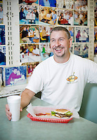 Sutton's Drugstore's burger and fries.'s lunch counter manager Don Pinney
