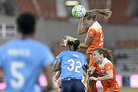 Houston, TX - Friday April 29, 2016: Cami Privett (23) of the Houston Dash heads the ball away from her side of the field against Sky Blue FC at BBVA Compass Stadium. The Houston Dash tied Sky Blue FC 0-0.