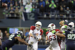 Arizona Cardinals quarterback Carson Palmer (3) passes against the Seattle Seahawks  at CenturyLink Field in Seattle, Washington on November 15, 2015. The Cardinals beat the Seahawks 39-32.   ©2015. Jim Bryant photo. All Rights Reserved.