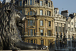 Landseer lion in Trafalgar Square looking over Whitehall buildings and statue of King Charles 1st, London