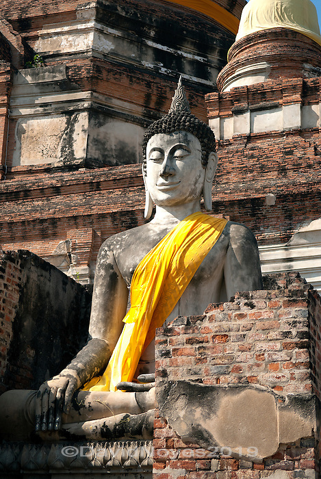 Hundreds of Buddha statues surround the main chedi at Wat Yai Chai Mongkohon, which is a short distance from Bangkok near the ancient capital of the southern Kingdom of Siam at Ayutthaya.