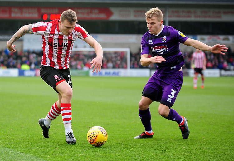 Lincoln City's Harry Anderson vies for possession with Grimsby Town's Sebastian Ring<br /> <br /> Photographer Andrew Vaughan/CameraSport<br /> <br /> The EFL Sky Bet League Two - Lincoln City v Grimsby Town - Saturday 19 January 2019 - Sincil Bank - Lincoln<br /> <br /> World Copyright &copy; 2019 CameraSport. All rights reserved. 43 Linden Ave. Countesthorpe. Leicester. England. LE8 5PG - Tel: +44 (0) 116 277 4147 - admin@camerasport.com - www.camerasport.com