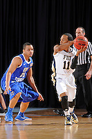 12 January 2012:  FIU guard Phil Taylor (11) handles the ball while being defended by Middle Tennessee guard Jimmy Oden (20) in the first half as the Middle Tennessee State University Blue Raiders defeated the FIU Golden Panthers, 70-59, at the U.S. Century Bank Arena in Miami, Florida.