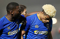 Adedeji Oshilaja of AFC Wimbledon leads Lyle Taylor away from the melee during the Sky Bet League 1 match between AFC Wimbledon and Charlton Athletic at the Cherry Red Records Stadium, Kingston, England on 10 April 2018. Photo by Carlton Myrie / PRiME Media Images.