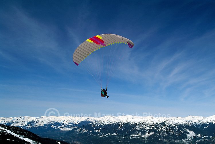 Whistler, BC, British Columbia, Canada - Paraglider flying at Paragliding Meet on Blackcomb Mountain (Coast Mountains), Whistler Resort, Winter
