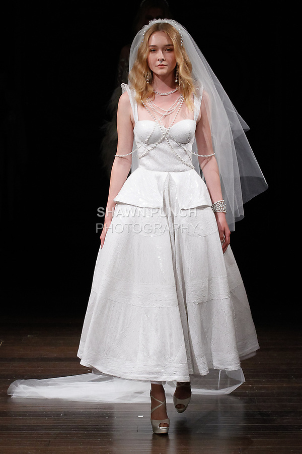 """Model walks runway in a """"Dover"""" bridal gown from the Naeem Khan Bridal Spring 2018 collection, on April 21, 2017; during New York Bridal Fashion Week."""