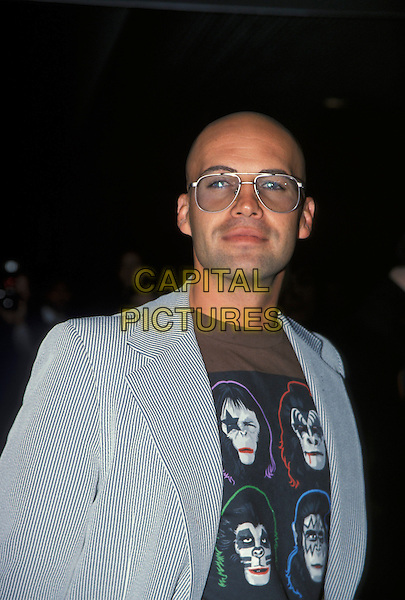 BILLY ZANE.London, 20th August 2001.half length sunglasses car grey suit monkey t shirt.Ref: AH.www.capitalpictures.com.sales@capitalpictures.com.©Capital Pictures.
